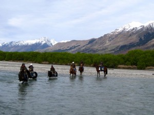 crossing-a-stream-on-horseback-new-zealand