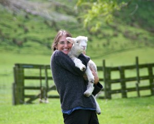 gina-holding-a-lamb-new-zealand